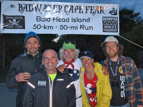 BADWATER CAPE FEAR Finish Line. From left: Bradford Lombardi, Time Finholm, Jim Schroe de r, Je nni Holle nbeck and Ke ith Hanson. Photo by Chris Kostman, Adve nture CORPS, Inc.